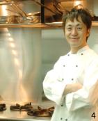 素敵な笑顔の田中シェフ。国内の様々な飲食店で経験を積んだ後、イタリアに学び、帰国後神戸の有名店を経て、地元大津に凱旋。